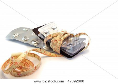 Tablets And Measuring Tape, Symbol Photo For Appetite Suppressants, Diet Pills And Slimming Mania