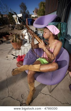 Black Woman On Back Patio Kissing Rifle