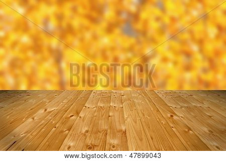 Wooden Floor And Defocused Autumn Forest