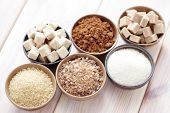 stock photo of white sugar  - lots of various brown sugar  - JPG