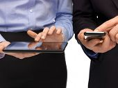 pic of sms  - woman and man hands with smartphone and tablet pc - JPG