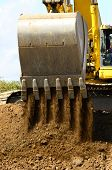 picture of track-hoe  - A large track hoe exchavator loads digging up a hill at a new road project in Oregon - JPG