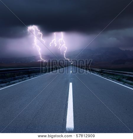 Driving On Asphalt Road Towards The Thunderbolts