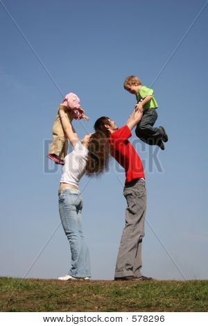 Family With Two Children On Hands