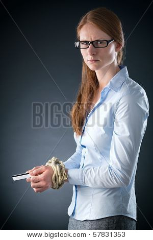 Sad Businesswoman Tied Up In Credit Debt