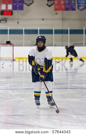 Female ice hockey player during a pre-game warm-up