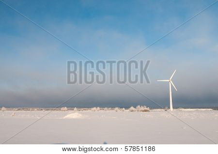 Windmill and blue sky in winter