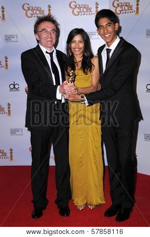Danny Boyle with Freida Pinto and Dev Patel in the press room at the 66th Annual Golden Globe Awards. Beverly Hilton Hotel, Beverly Hills, CA. 01-11-09