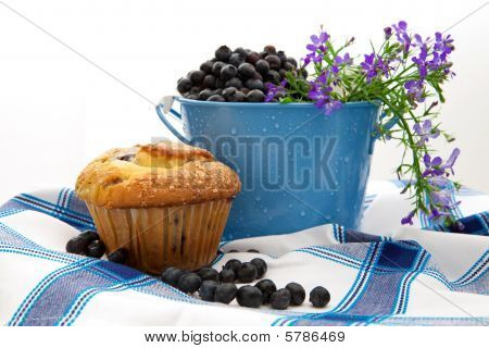 Fresh Blueberries In A Pail With A Blueberry Muffin