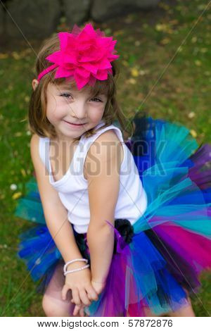 Little Girl All Dressed Up In A Colourful Tutu.