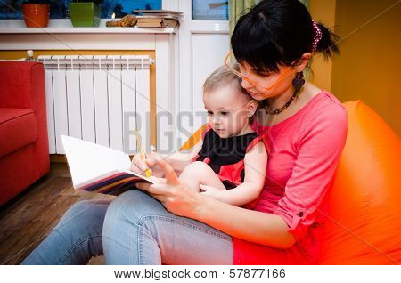 Baby In Ladybird Costume Draws With Her Mother