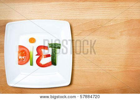 Plate With Vegetables And Word Diet Over Wooden Background