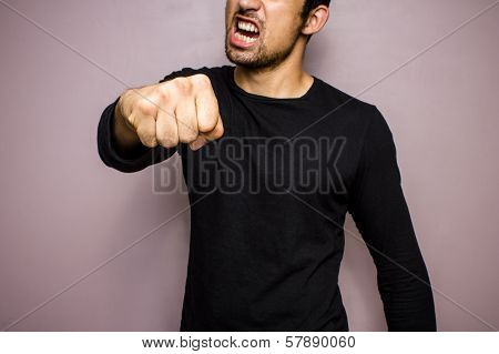 Angry Man Throwing A Punch