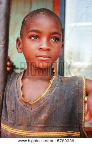 Poor african boy looking sad with a blank look on his face