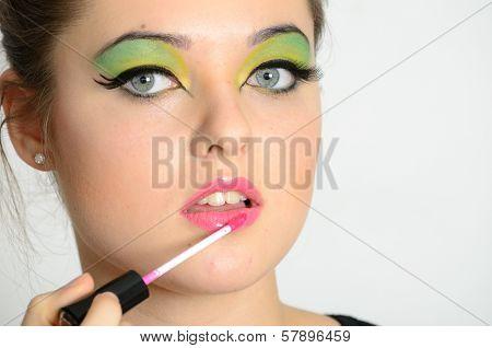 Girl Using Lip Gloss
