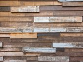 stock photo of untidiness  - Old style untidy wooden wall for background - JPG
