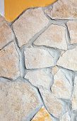 image of porphyry  - Wall lined with light yellow porphyry stones - JPG
