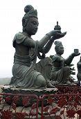stock photo of lantau island  - Buddhist Statues praising the big Buddha on Lantau island - JPG