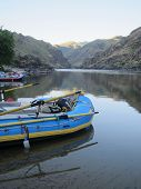 stock photo of raft  - Rafts and gear on peaceful river - JPG