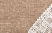 stock photo of rude  - Burlap rude background and white lacy cloth - JPG