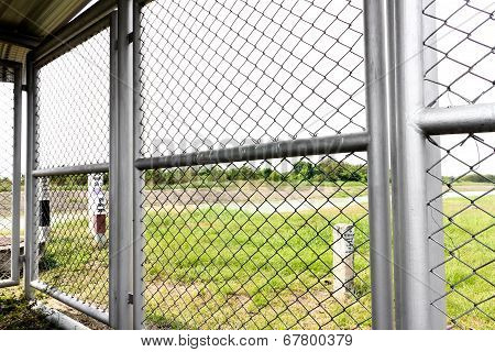 Wire Fence Field On Background
