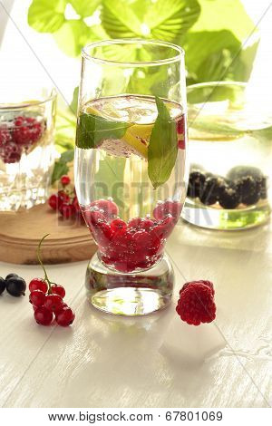 Different types of cold drink with berries