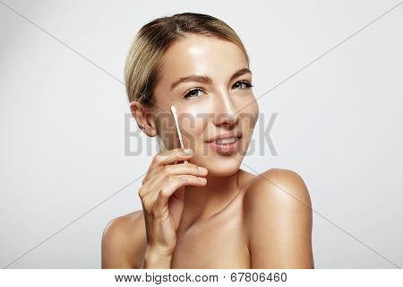 Woman With A Cotton Swab
