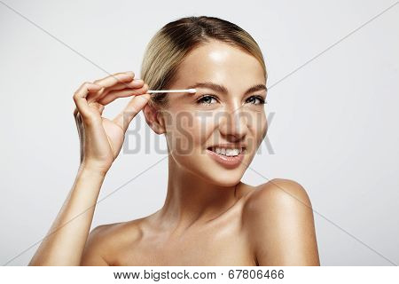Happy Woman With A Cotton Swab