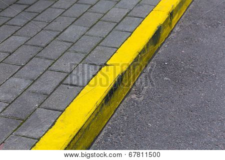 Yellow Curb Line On The Road