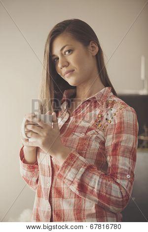 girl drinks a coffee