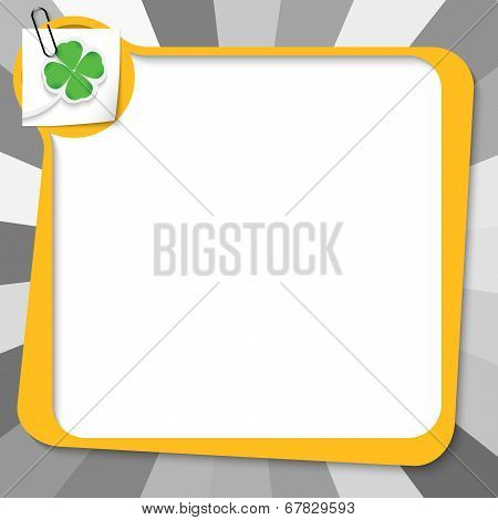 Yellow Text Box With Paper Clip And Cloverleaf