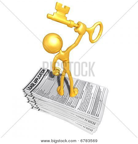 Gold Guy With Lease Application And Gold Key