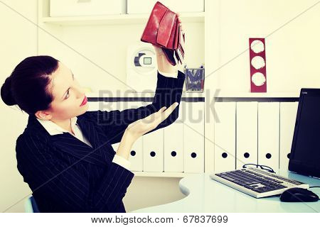 business woman is holding empty wallet, in office.Bankruptcy concept.