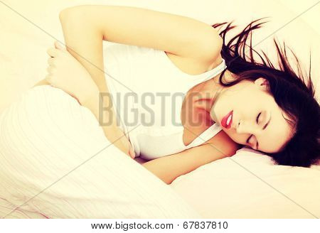 A photo of woman with stomach ache. Illness concepion.