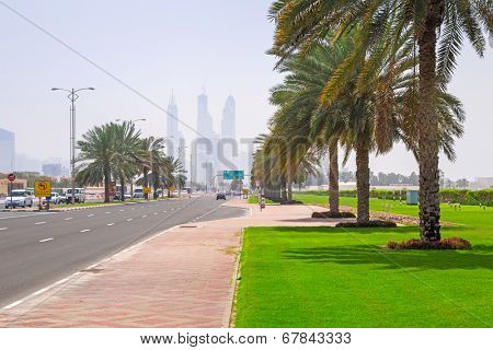 DUBAI, UAE - 1 APRIL 2014: Streets of Dubai at the Jumeirah Beach, UAE. Jumeirah Beach is a white sand beach that is located and named after the Jumeirah district of Dubai.