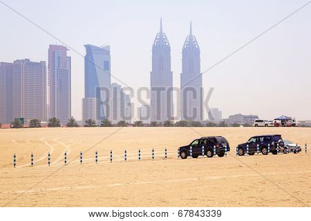 DUBAI, UAE - 1 APRIL 2014: Cars parked at the Jumeirah Beach in Dubai, UAE. Jumeirah Beach is a white sand beach that is located and named after the Jumeirah district of Dubai.