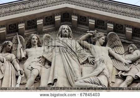PARIS,FRANCE - NOV 09,2012:Saint Matthew the Evangelist, architectural details of Eglise de la Madeleine. Madeleine Church was designed in its present form as a temple to the glory of Napoleon's army.