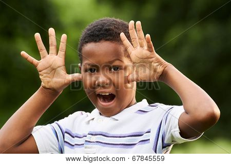 Happy African Boy Making A Grimace At Camera
