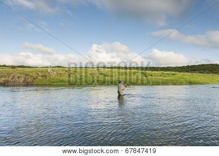 Man fishing for salmon in a beautiful surrounding