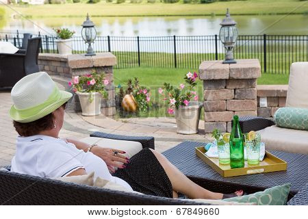 Elegant Senior Lady Relaxing On Her Patio