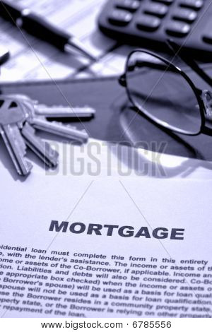 Real Estate Mortgage Document On Realtor Desk