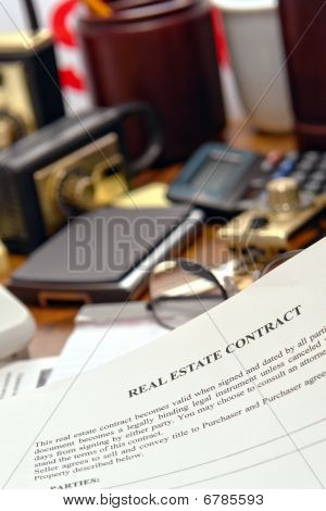Real Estate Contract Document On Realtor Desk