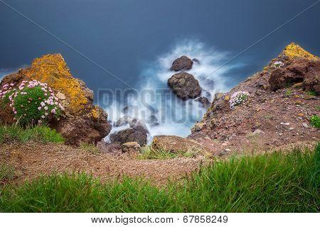 Long exposure image of rocks in wawes