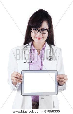 Female Practitioner Showing Digital Tablet