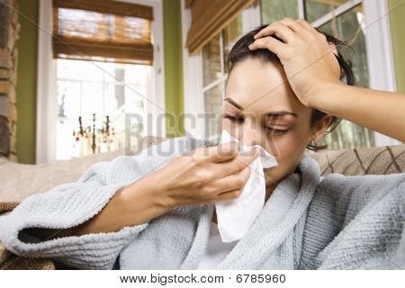 Ill Young Woman Blowing Nose