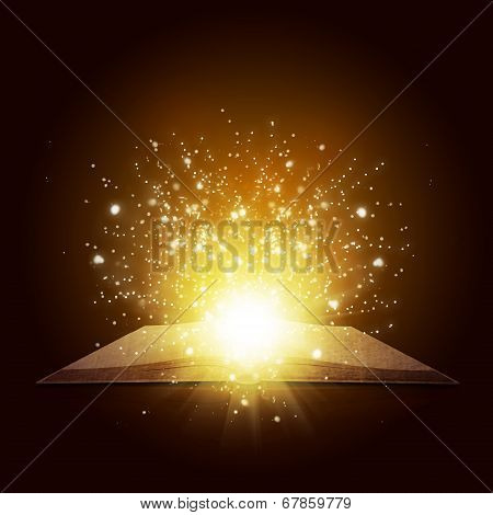 Old open book with magic light and falling stars