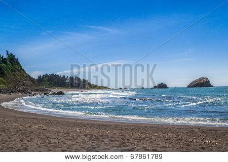 Beach And Rocks