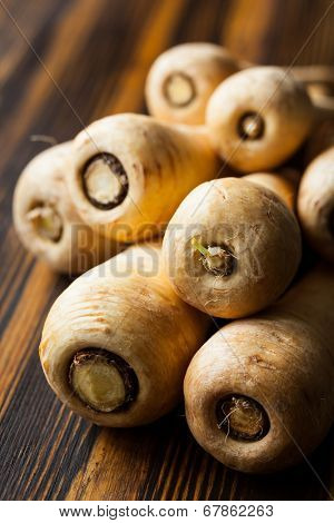 Fresh parsnip on wooden table