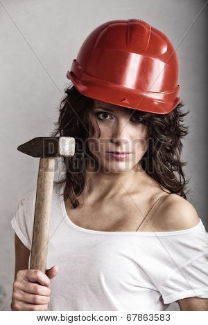 Sexy Girl In Safety Helmet Holding Hammer Tool