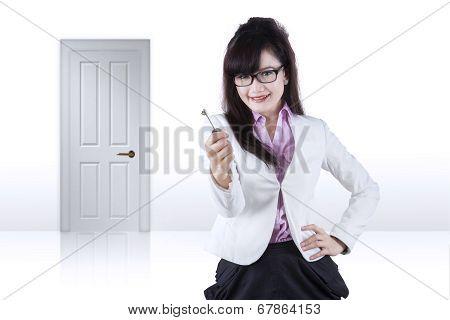 Pretty Woman Giving A Key 1